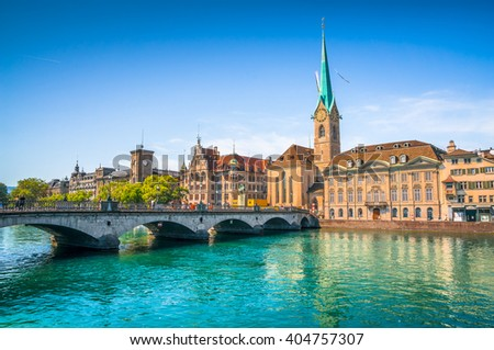 Panoramic view of the historic city center of Zurich with famous Fraumunster Church and munsterbrucke with river Limmat on a sunny day with blue sky, Canton of Zurich, Switzerland - stock photo