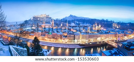 Panoramic view of the historic city of Salzburg with Festung Hohensalzburg and river Salzach in winter, Salzburger Land, Austria - stock photo