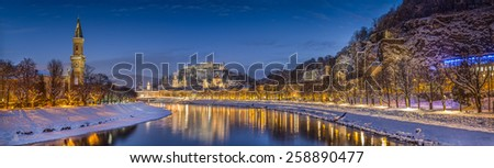 Panoramic view of the historic city of Salzburg with Salzach river in winter during blue hour, Salzburger Land, Austria - stock photo