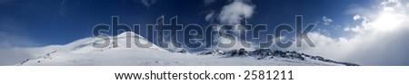 Panoramic view of the main Caucasian mountain ridge. View on Elbrus, 3500m - stock photo