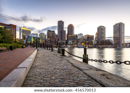 Panoramic view of the mix of modern and historic architecture of Boston in Massachusetts, USA at sunset showcasing the Boston harbor and Financial District. - stock photo