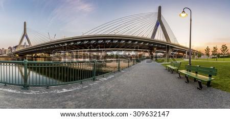 Panoramic view of the modern architecture of the Zakim Bridge in Boston, Massachusetts, USA at sunset. - stock photo