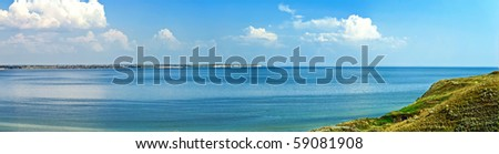 Panoramic view of the sea bay with green hills - stock photo