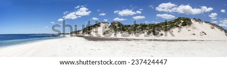 Panoramic view of the soft white sandy beach and dunes  at Hutt's beach near Bunbury western Australia on a cloudy early summer afternoon. - stock photo
