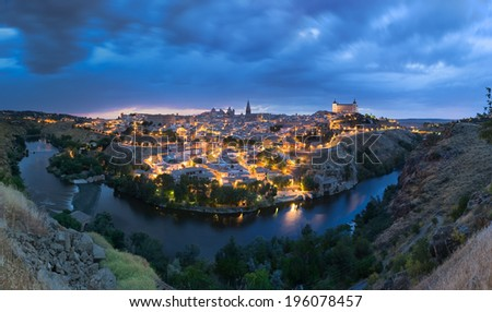 Panoramic view of Toledo after sunset, Spain - stock photo