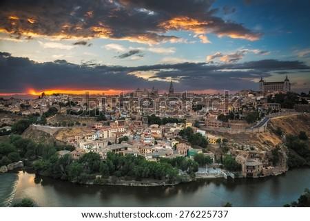 Panoramic view of Toledo at dusk, Castile-La Mancha, Spain - stock photo