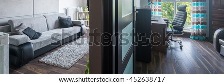 Panoramic view of two rooms in small and modern apartment - stock photo