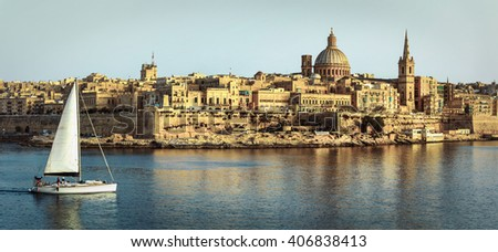 panoramic view of Valetta over sunset and with a sail boat. Malt - stock photo