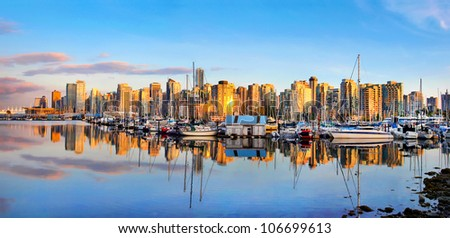 Panoramic view of Vancouver skyline at sunset as seen from Stanley Park, BC, Canada - stock photo