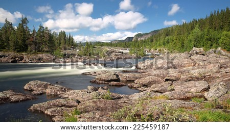 Panoramic view of Waterfall Litsjforsen - North Sweden near Vilhelmina - stock photo