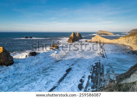 Panoramic view of waves breaking in cantabrian coast - stock photo