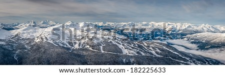 Panoramic view of Whistler Mountain in winter after a snow storm, from Blackcomb Mountain - stock photo