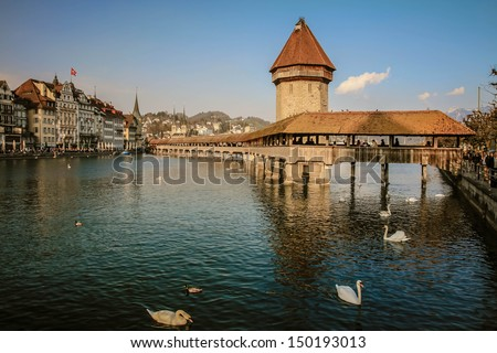 Panoramic view of wooden Chapel bridge and old town of Lucerne, Switzerland - stock photo