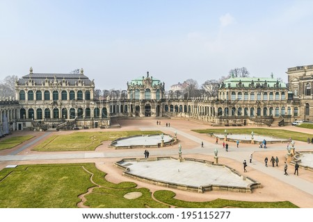 Panoramic view of Zwinger. Zwinger Palace (architect Matthaus Poppelmann) - royal palace since 17 century in Dresden, Germany. Today, Zwinger is a museum complex and most visited monument in Dresden. - stock photo