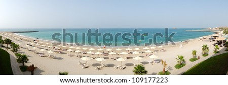 Panoramic view on a beach and turquoise water of the luxury hotel, Fujairah, UAE - stock photo