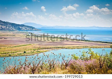 Panoramic view on Butrint lake and Vivari channel in National Park of Butrin, Albania. - stock photo