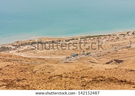 Panoramic view on Dead Sea shore with road and checkpoint at dawn. Judean desert, Metzoke Dragot, Israel.  - stock photo