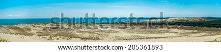 Panoramic view on dunes of the Curonian spit.The Curonian Spit is home to the highest drifting sand dunes in Europe - stock photo