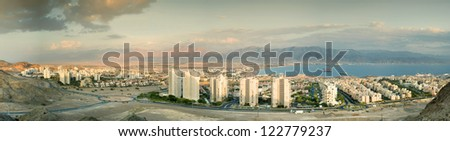 Panoramic view on Eilat (Israel) and Aqaba (Jordan) from surrounding hills - stock photo