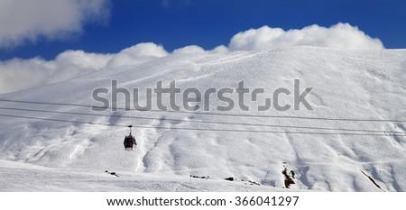 Panoramic view on gondola lift and off-piste slope. Caucasus Mountains, Georgia, region Gudauri. - stock photo