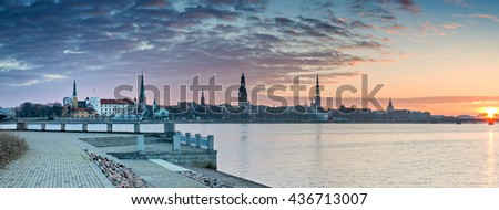Panoramic view on medieval city of Riga from embankment of the Daugava river. Riga is the capital of Latvia and famous Baltic city of medieval architecture - stock photo