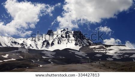 Panoramic view on ski resort in spring. Mount Erciyes, central Anatolia, Turkey. - stock photo