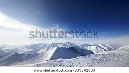 Panoramic view on snowy mountains at nice day. Caucasus Mountains, Georgia, ski resort Gudauri. Wide angle view. - stock photo
