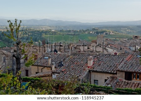 Panoramic view on Tuscan countryside from San Gimignano - stock photo