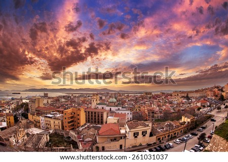 Panoramic view over Cagliari from bastion Santa Croce in a colorful sunset - stock photo