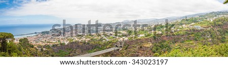 Panoramic view over Funchal, Madeira, Portugal with its harbor - stock photo