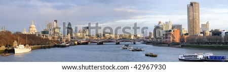 Panoramic view over the River Thames, London, England, UK to St Paul's Cathedral, and the City, in warm winter light - stock photo