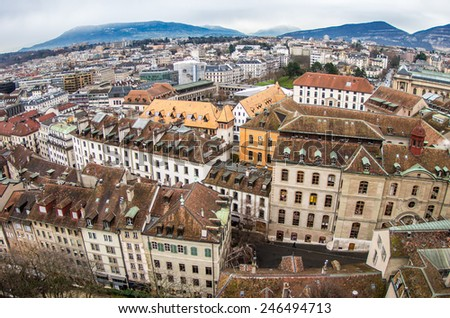 Panoramic view to historical center of Geneva, Switzerland, from Saint-Pierre cathedral in cloudy day at winter - architecture wallpaper - stock photo