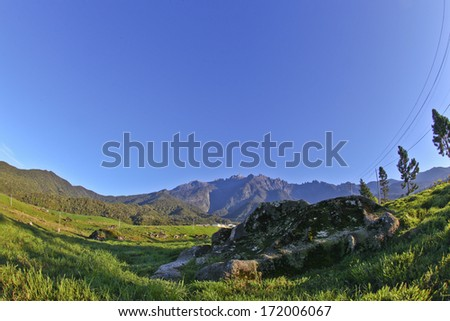 panoramic view using fish eye lens of mount kinabalu, malaysia highest mountain. - stock photo