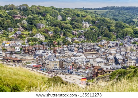Panoramic views of famous village d'Etretat - commune in the Seine-Maritime department in the Haute-Normandie region in northwestern France. Etretat is now a famous French seaside resort. - stock photo
