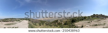 Panoramic views of the Golan Heights and Roman ruins at Umm Qais (Umm Qays) --is a town in northern Jordan near the site of the ancient town of Gadara.  - stock photo