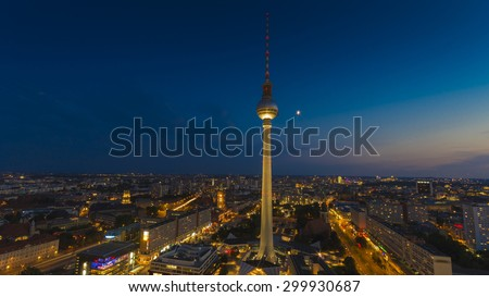 Panoramic views over the skyline of Berlin with the TV Tower. Photographed at night from the roof of the Park Inn hotel at Alexanderplatz - stock photo