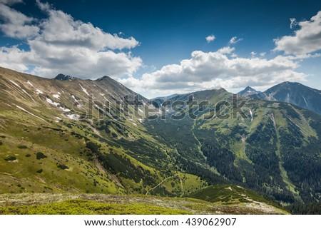 Panoramic vista over high peak mountains in Tatra National Park - stock photo