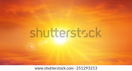 Panoramic warm sunset. High resolution sky background with a radiant setting sun - stock photo
