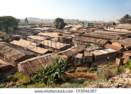 Panoriamic view of Kibera slums in Nairobi, Kenya. The largest slum of Africa is in Nairobi. About 270 thousand people living in Kibera. - stock photo