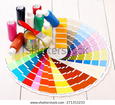 Pantone color palette, brush on white wooden background, top view - stock photo