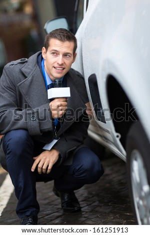 paparazzi hiding behind a car  - stock photo