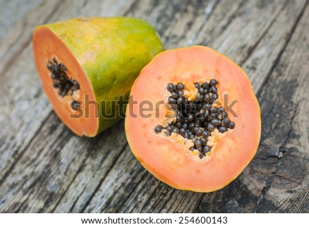 papaya fruit on wooden board - stock photo