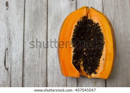 papaya on wood table - stock photo