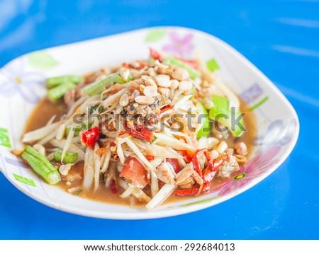 papaya salad, spicy green papaya salad  Local Cuisine  Thailand - stock photo