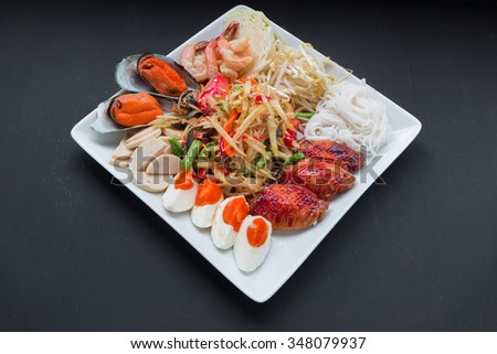 papaya salad with egg and chicken and vegetable  - stock photo