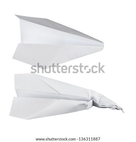 Paper airplane set isolated over white, battered and normal one - stock photo
