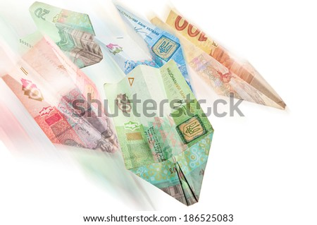 Paper airplanes of Ukrainian money - stock photo