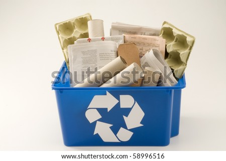 Paper and cardboard in a blue recycling bin. White background. - stock photo