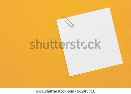 paper and paper clip on background - stock photo