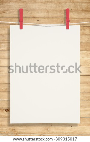 Paper and red clip on woods wall for text and background.copy space - stock photo